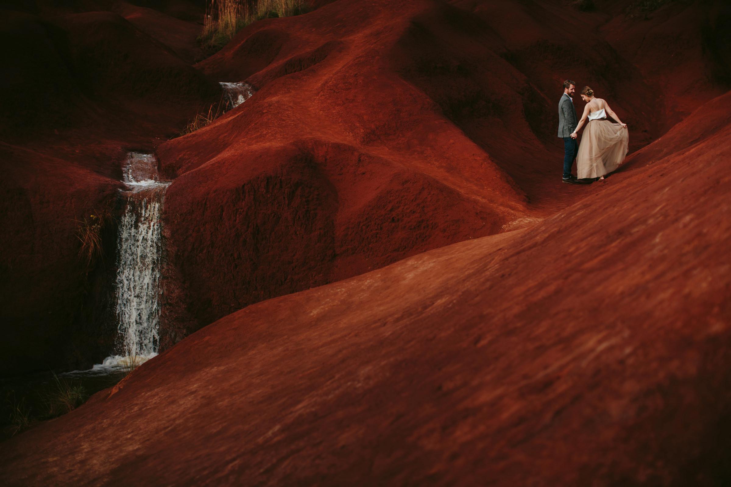 Engagement photo at Maui waterfall - photo by Melia Lucida