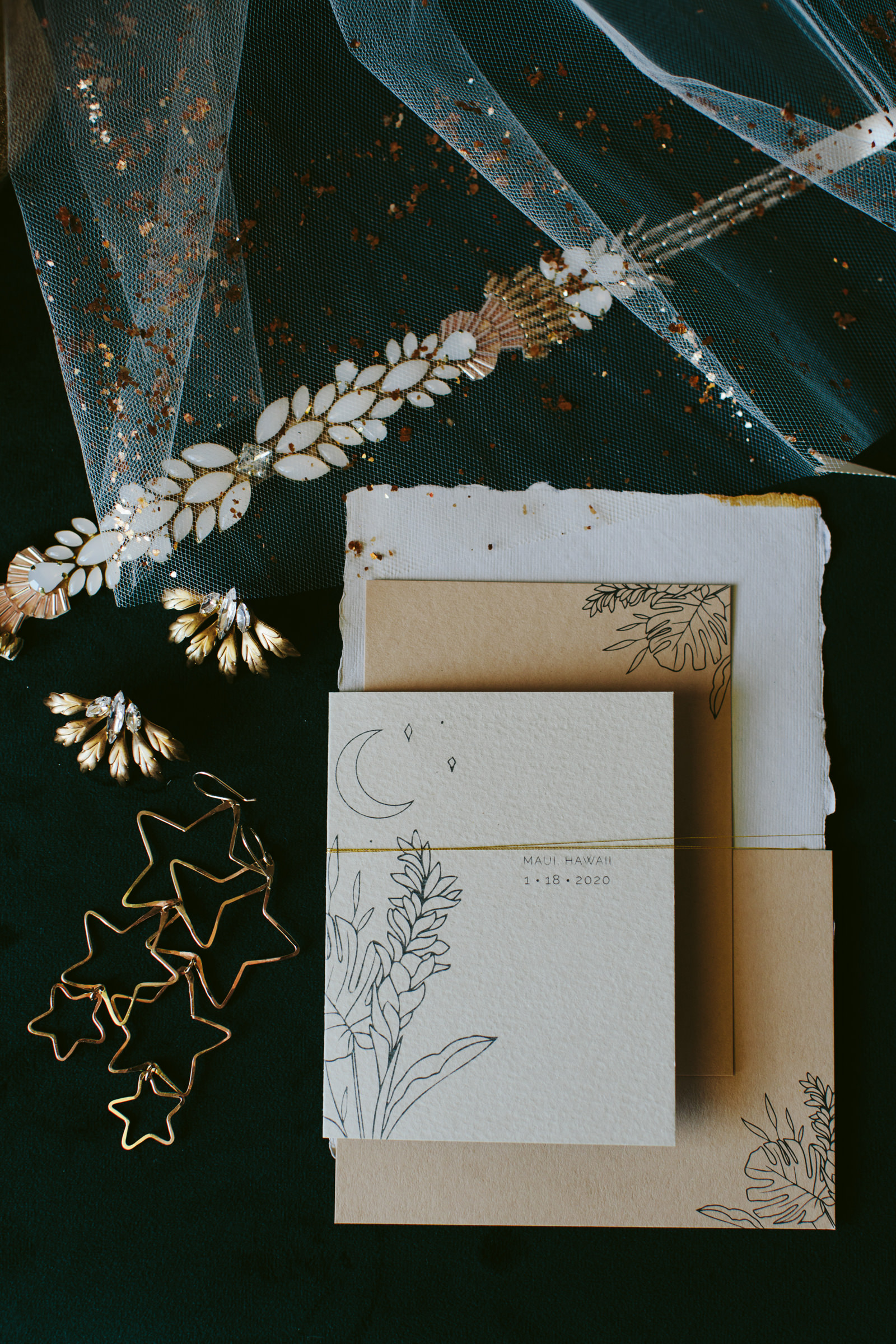 Flatlay with stationery and jewelry - photo by Melia Lucida