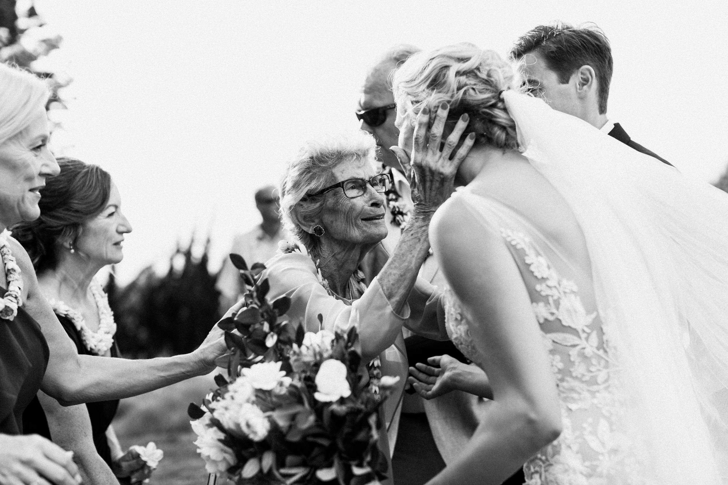 Grandmother embraces bride - photo by Melia Lucida