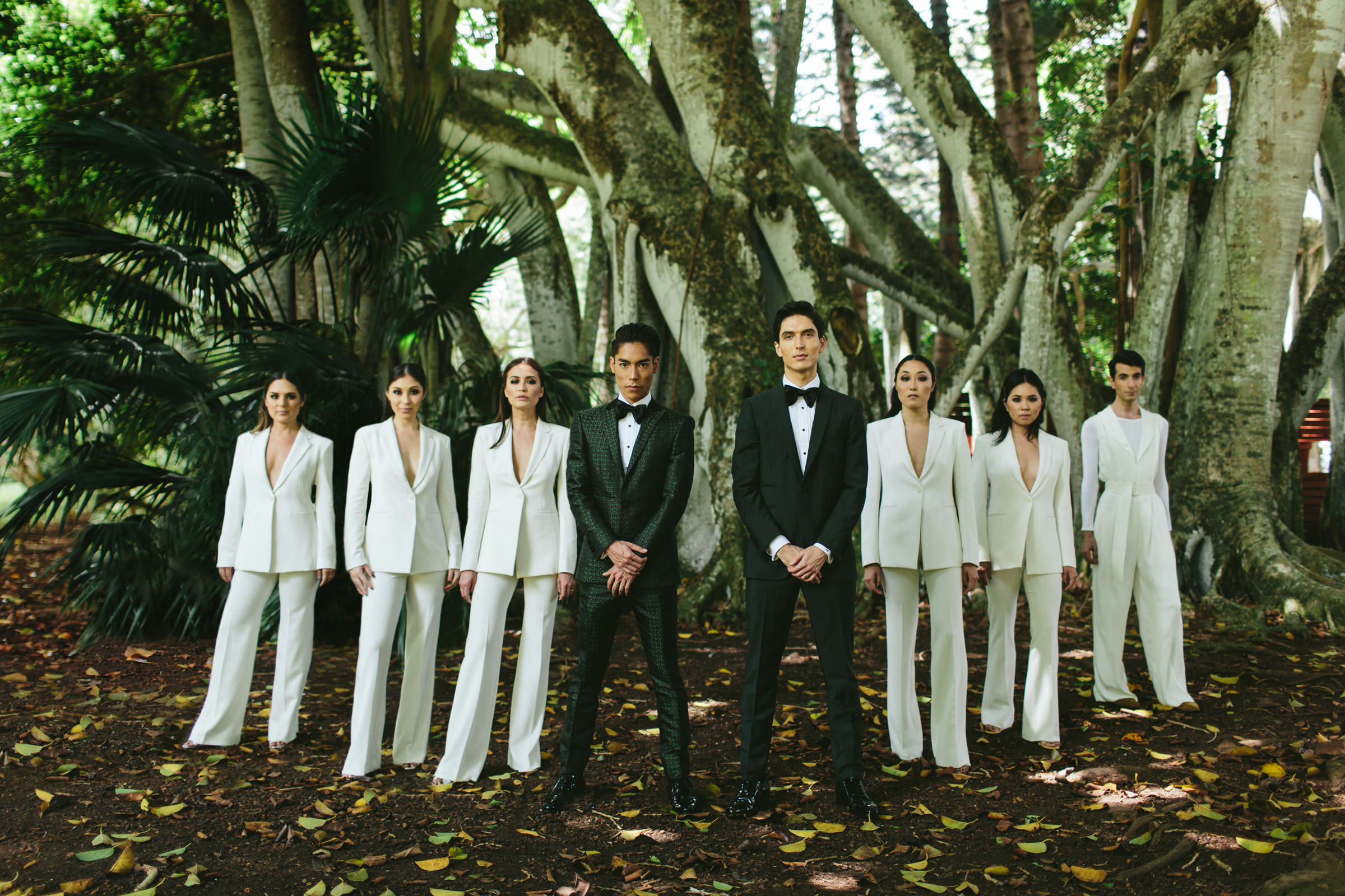 Grooms and bridal party dressed in black and white maui - photo by Melia Lucida