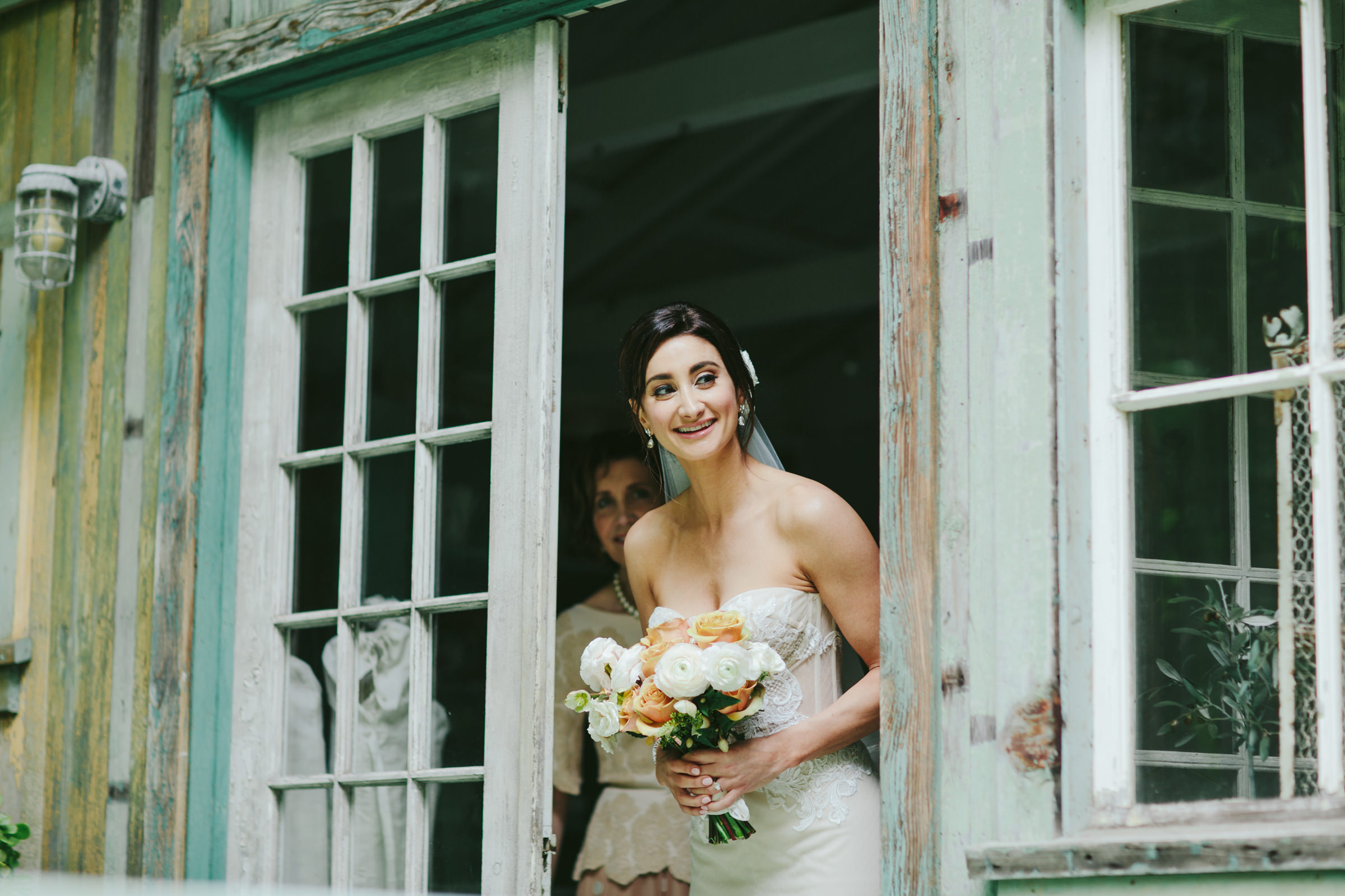 Haiku Mill Maui bridal portrait in window - photo by Melia Lucida
