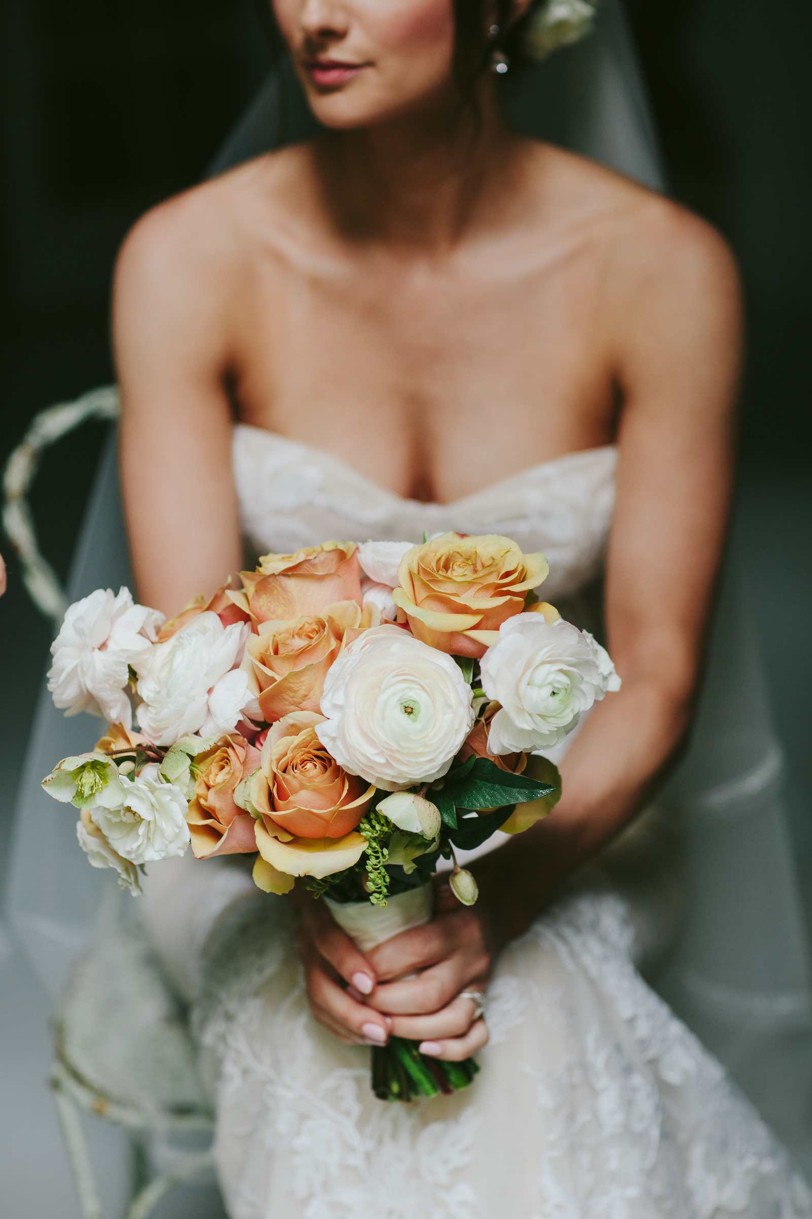 Haiku Mill Maui bride with rose and ranunculus bouquet - photo by Melia Lucida