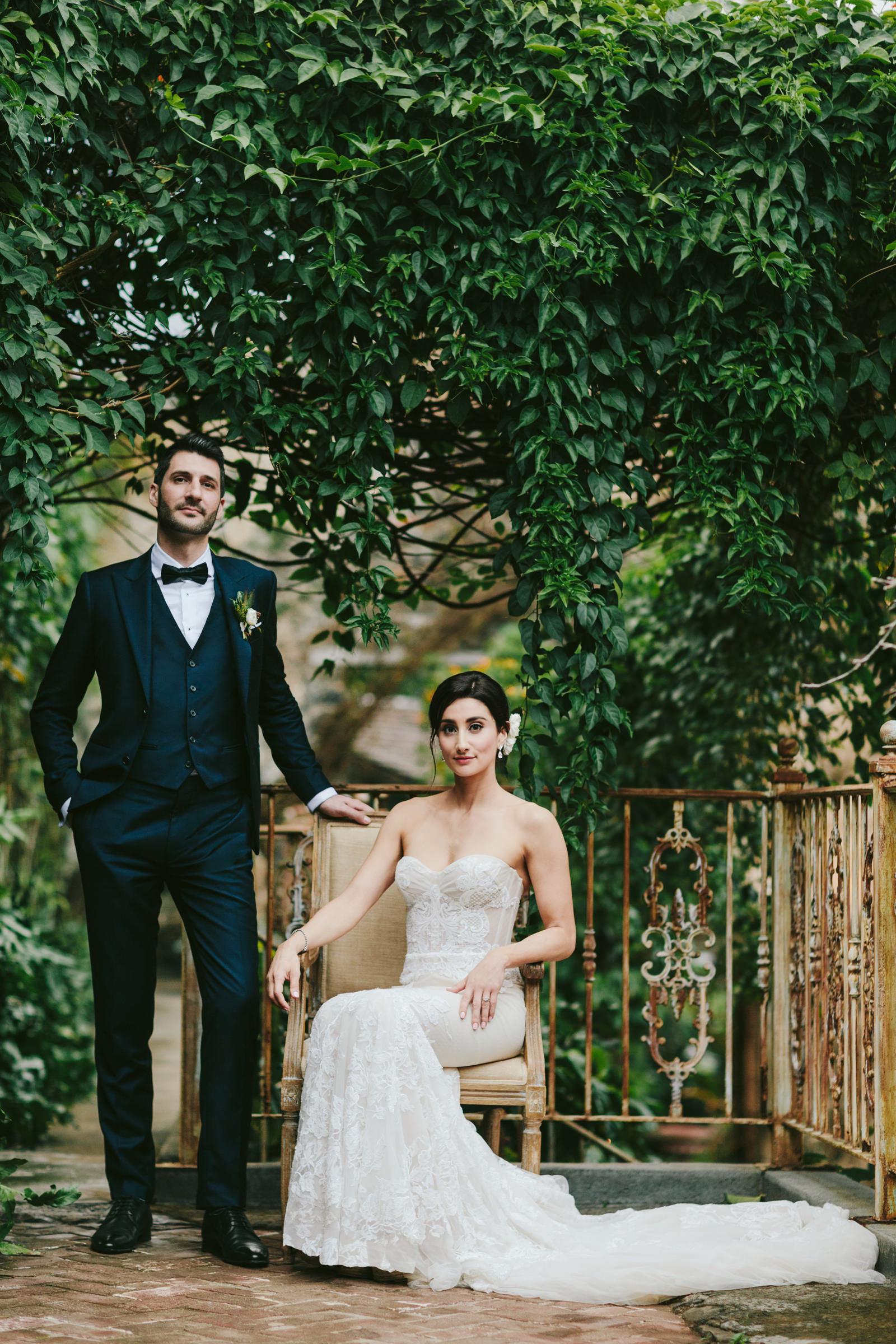 Haiku Mill Maui couple portrait with groom standing - photo by Melia Lucida