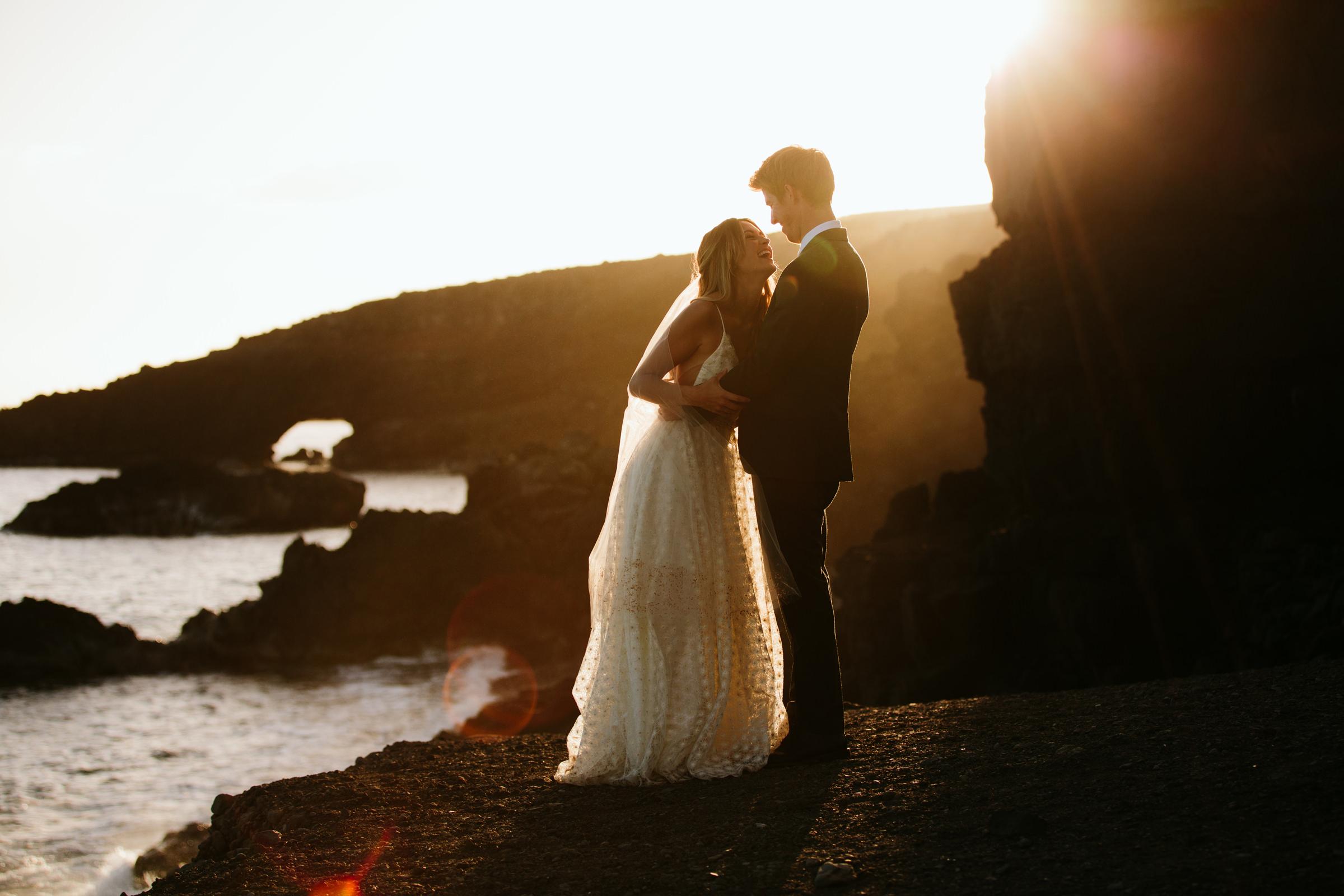 Hotel Wailea Maui backlit bride and groom on dramatic coast - photo by Melia Lucida