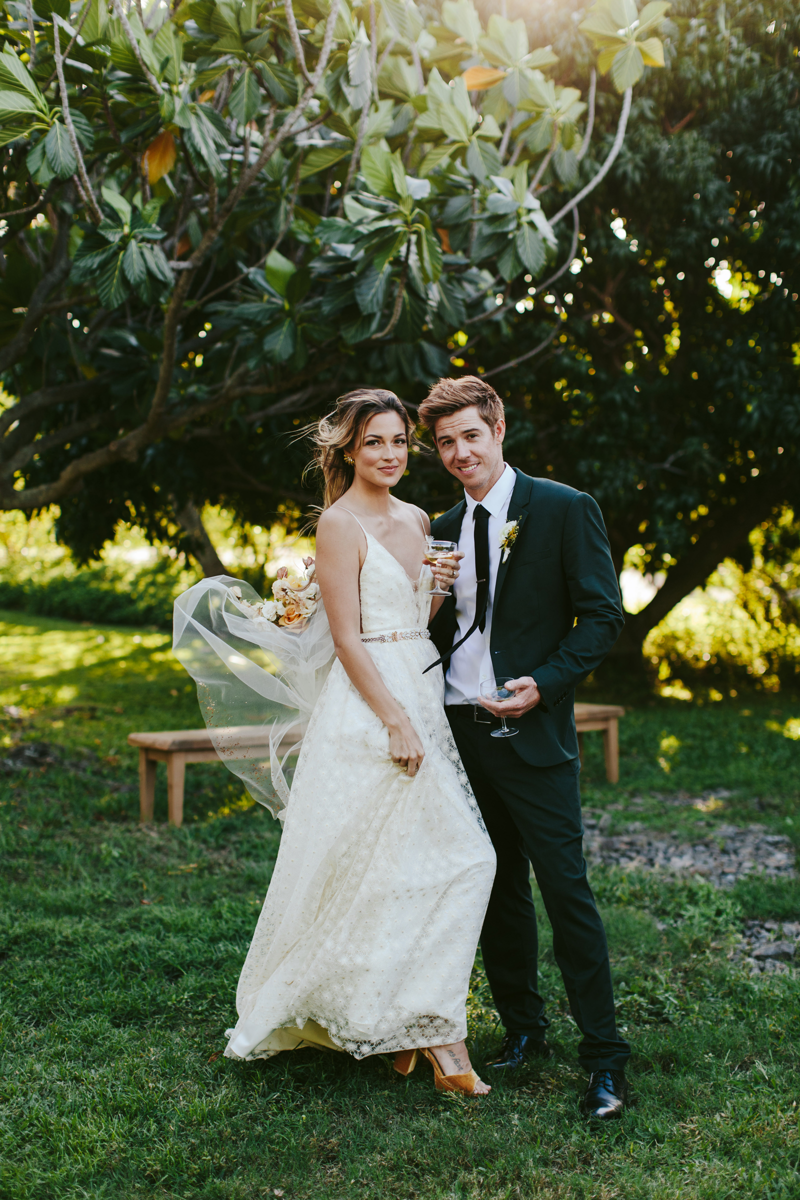Hotel Wailea Maui bride and groom in garden breeze  - photo by Melia Lucida