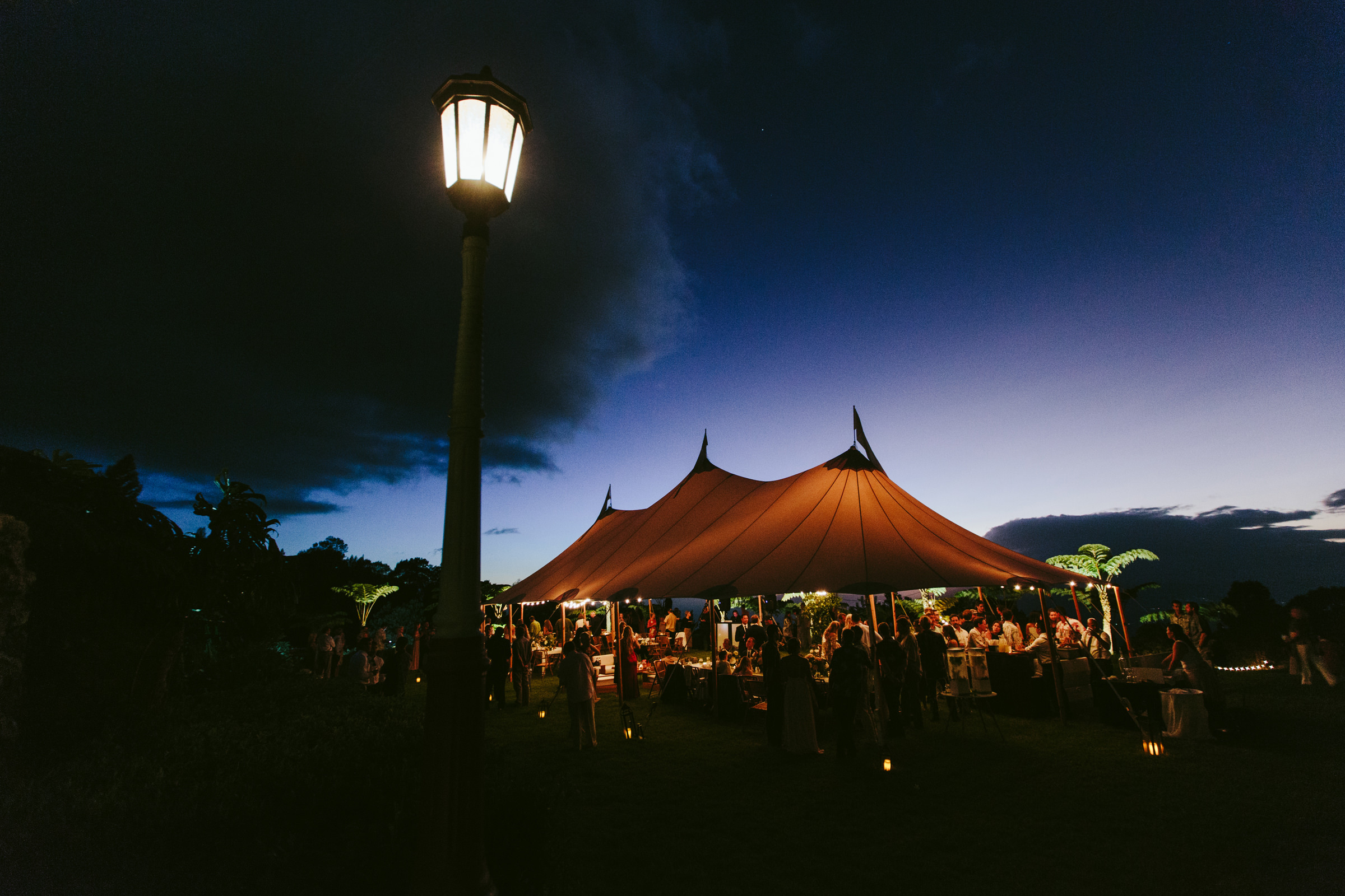 Maui reception tent glowing in evening light - photo by Melia Lucida