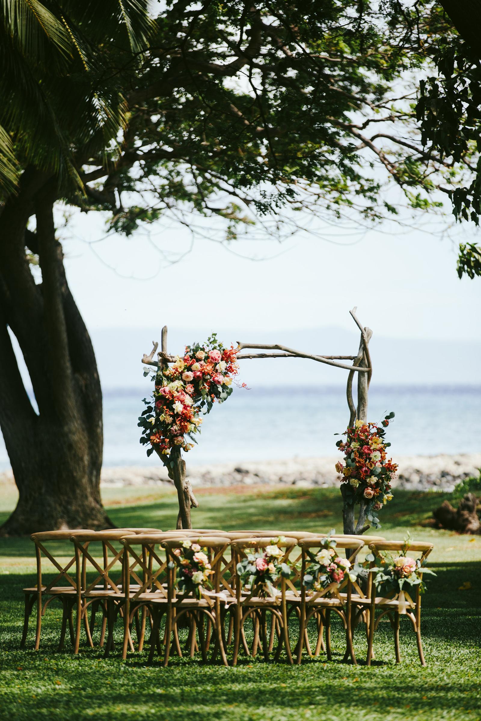Olowalu Plantain House wedding arbor and ceremony seating - photo by Melia Lucida