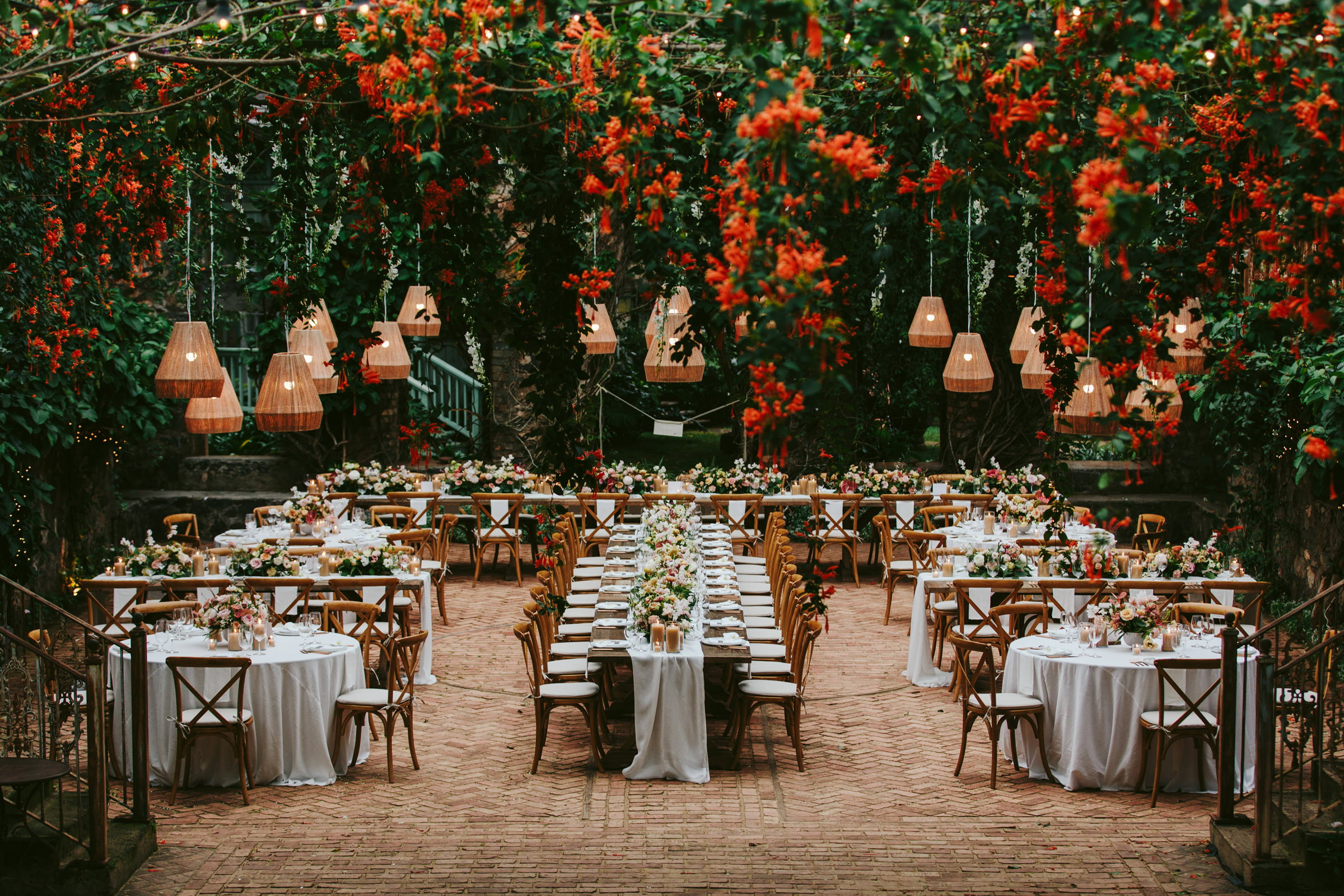 Reception decor in tangerine and white - photo by Melia Lucida