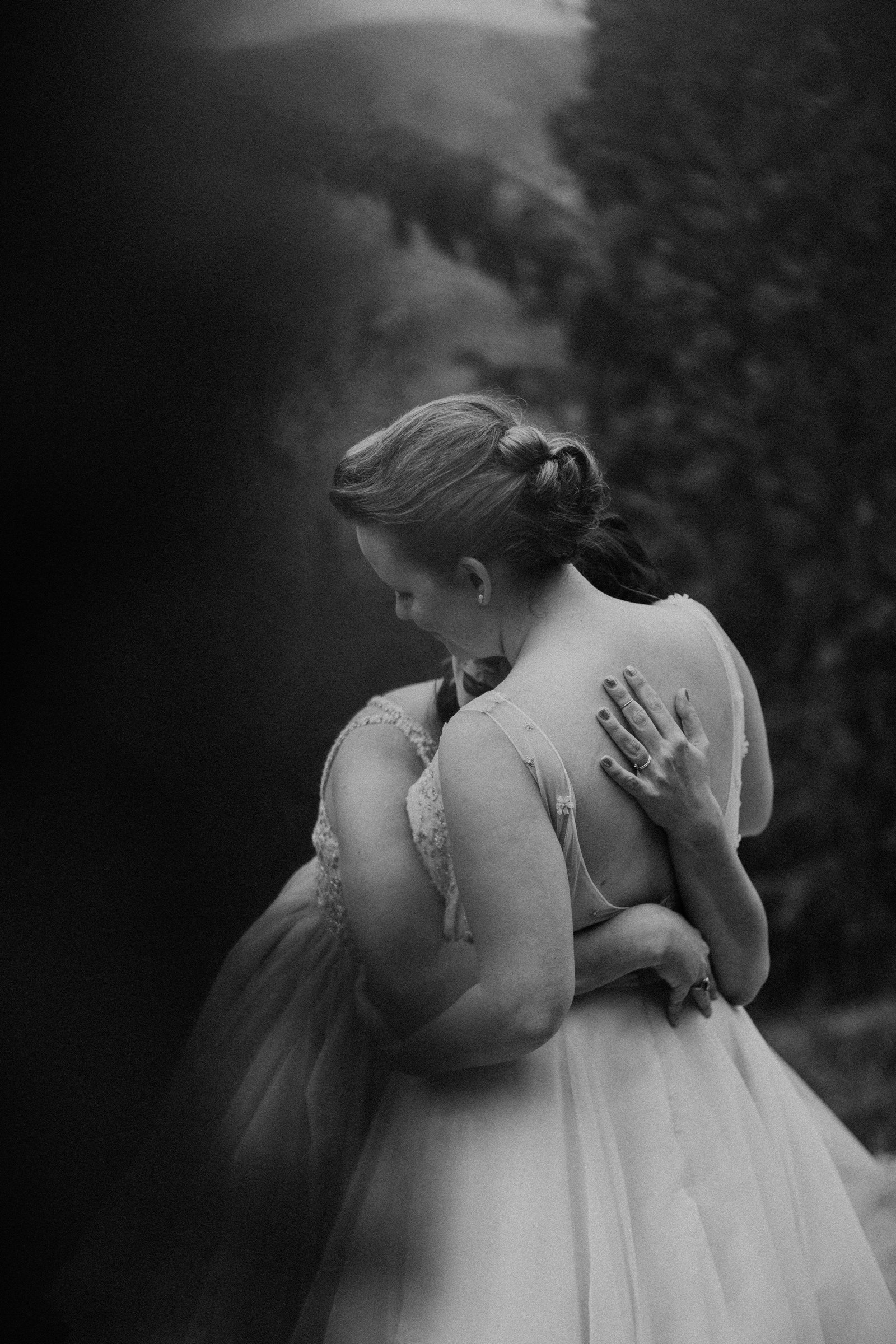 two brides embrace - photo by Melia Lucida