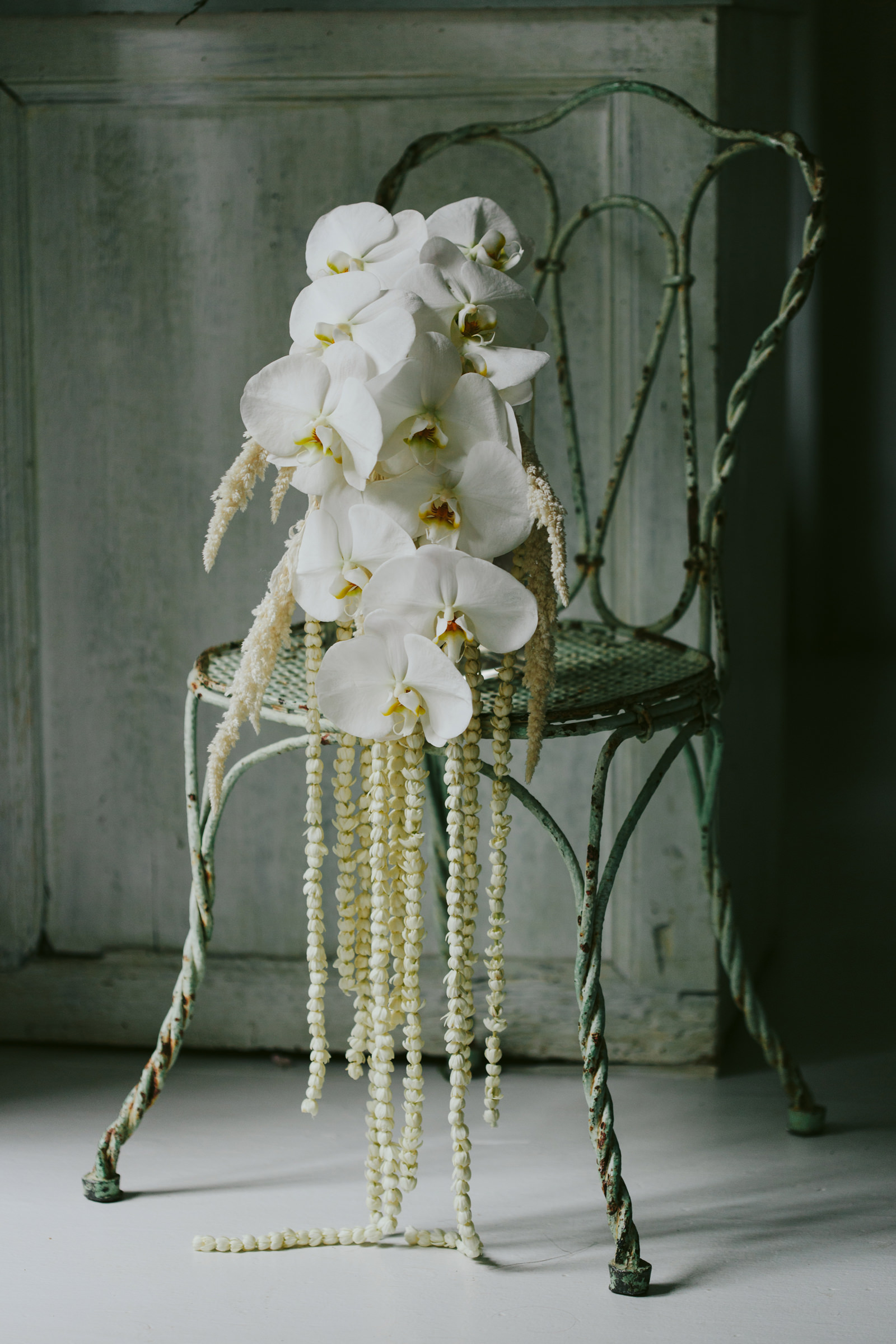 White orchid bouquet - photo by Melia Lucida