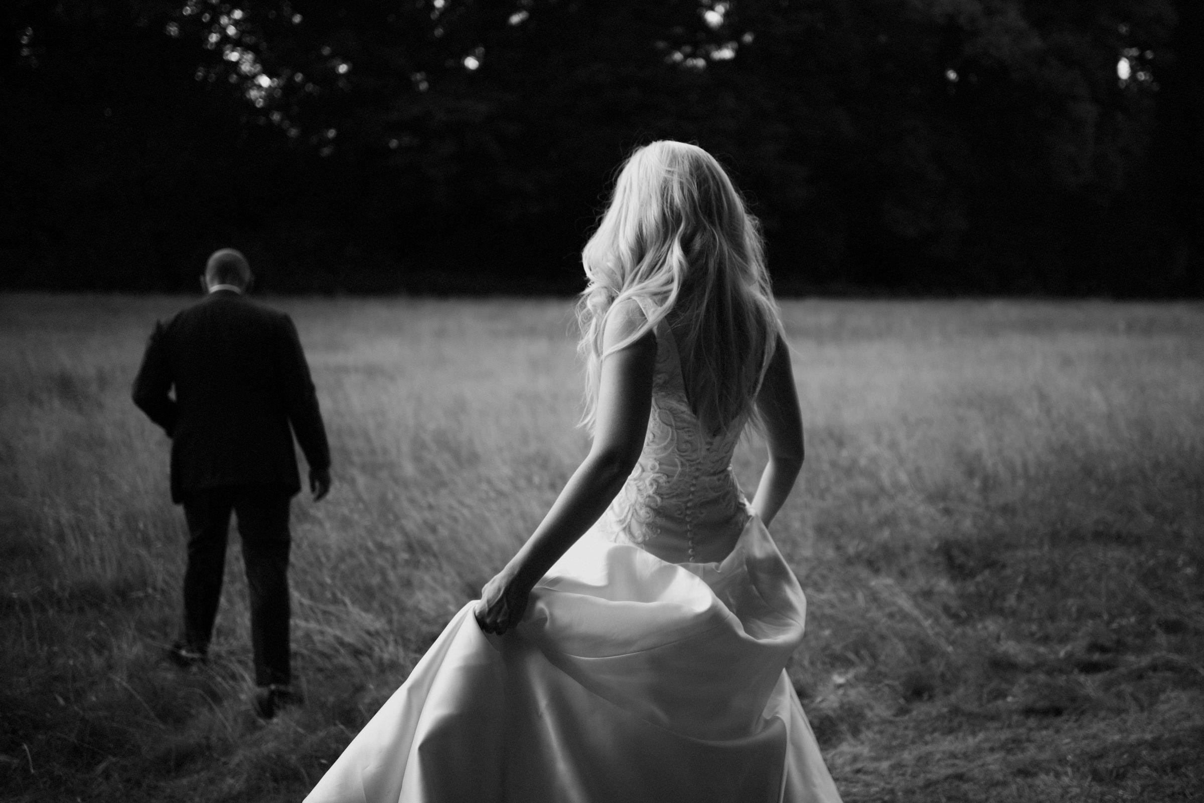 Bride follows groom out of doors - photo by Naomi van der Kraan