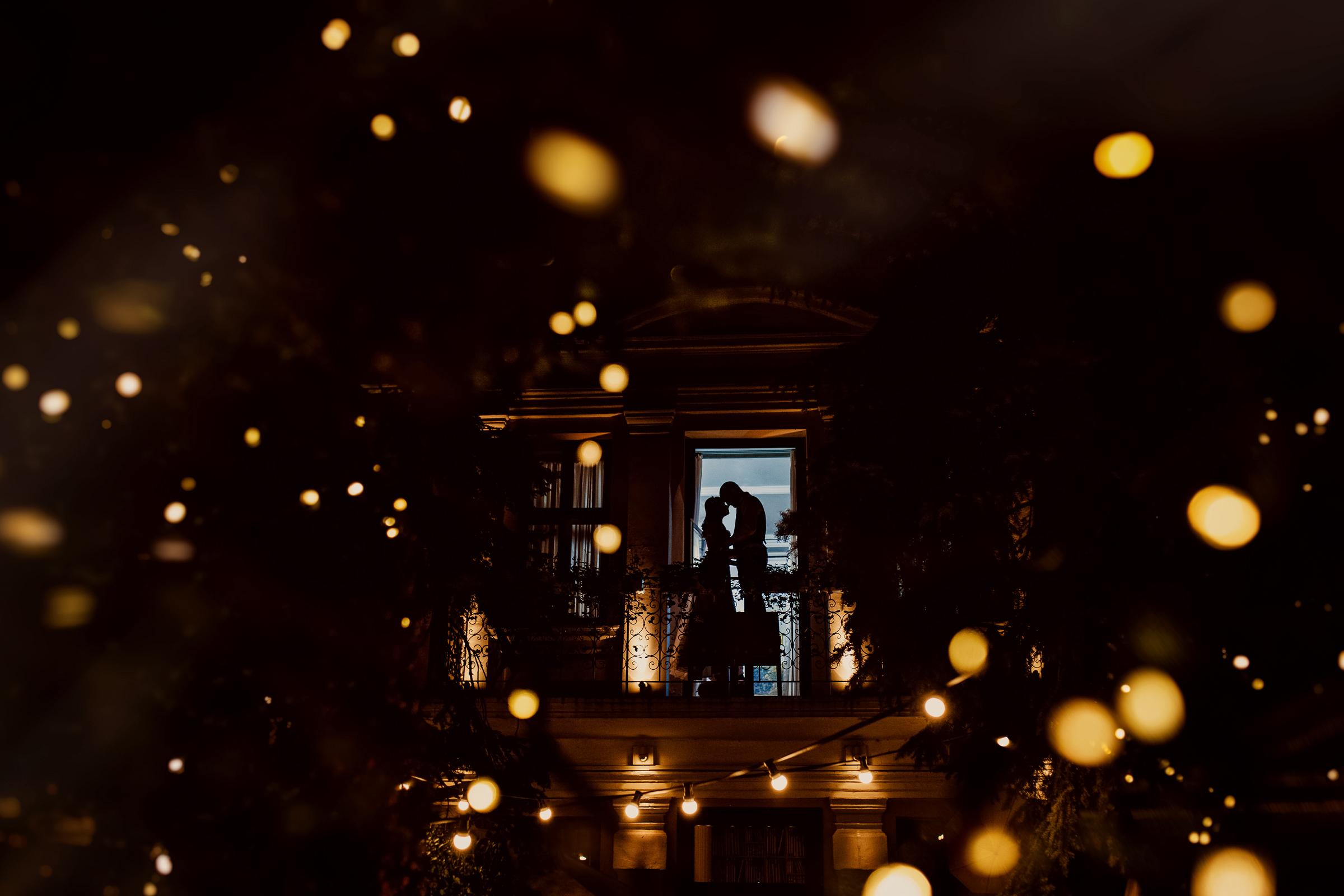 Bokeh lighting silhouette against doorway - photo by Deliysky Studio
