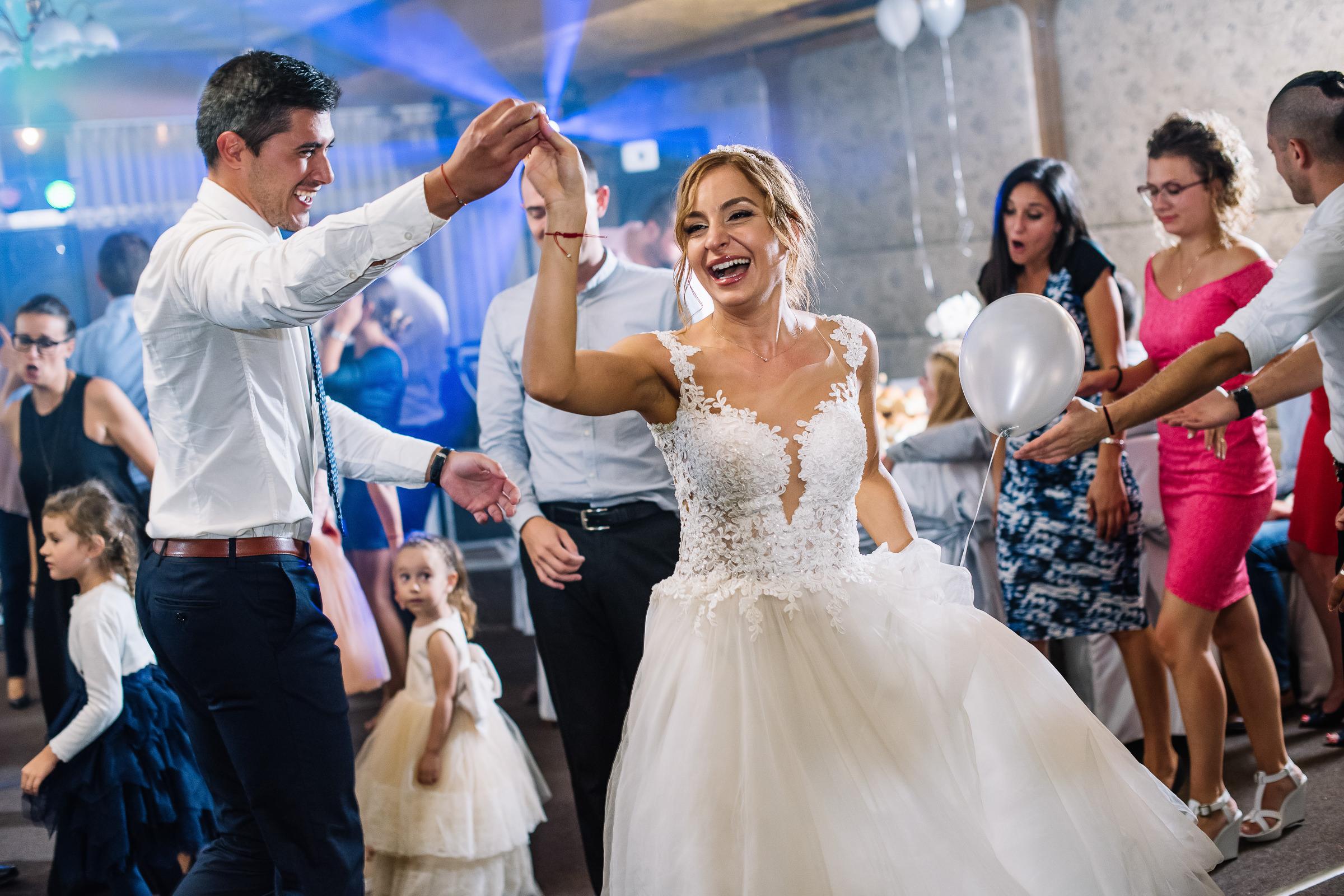 bride and groom dancing at reception party- photo by Deliysky Studio