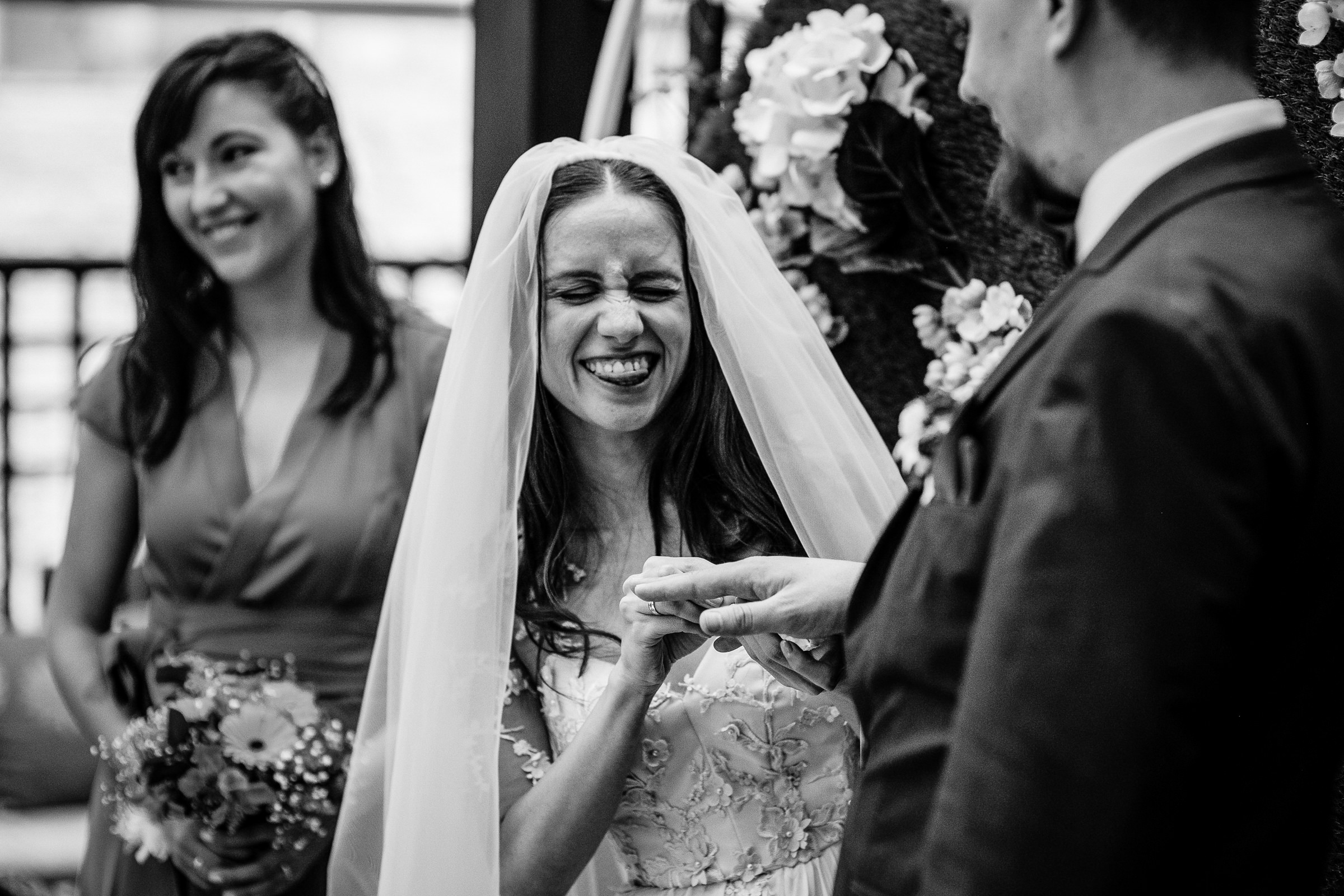 Bride makes funny face at groom during ceremony - photo by Deliysky Studio