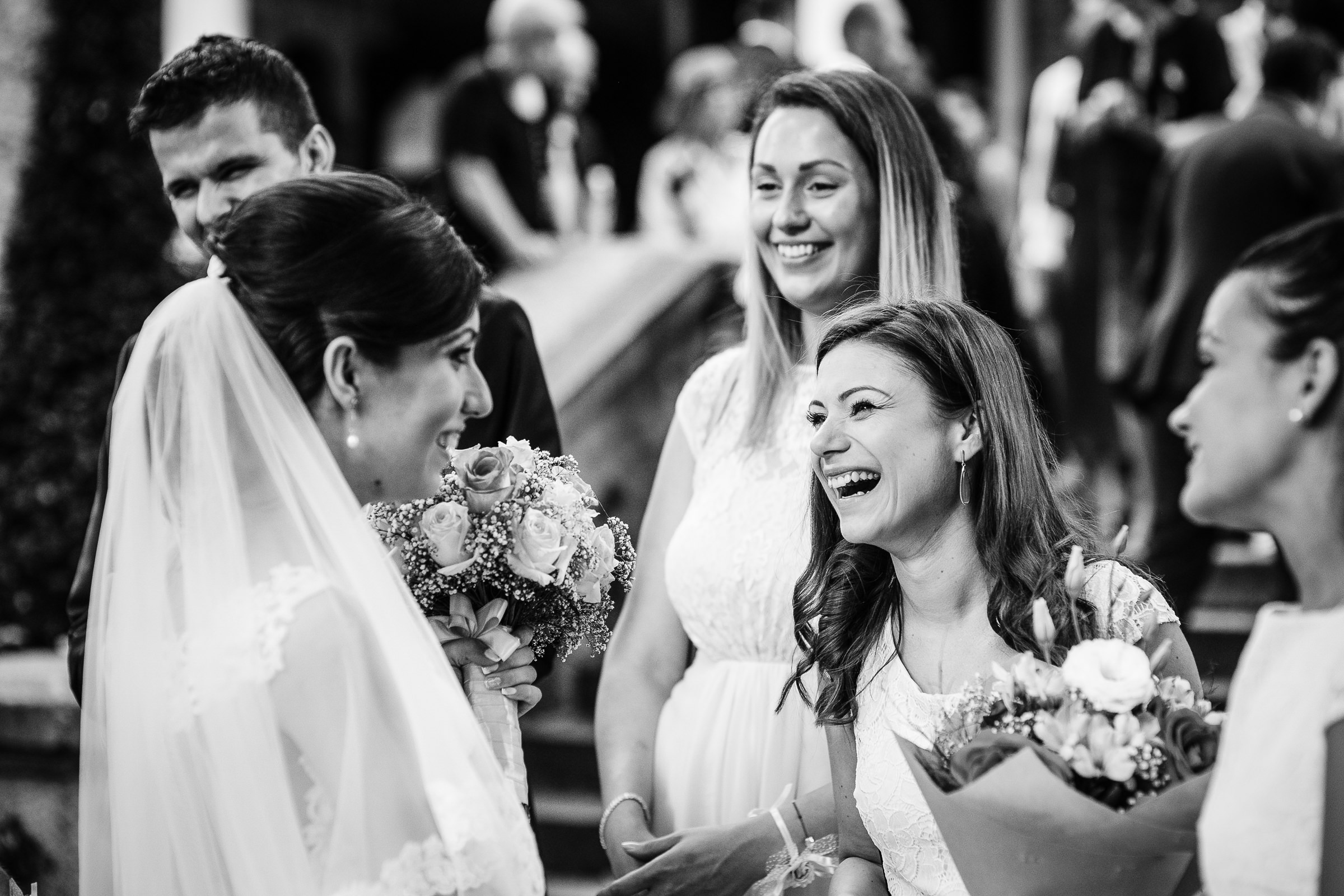 Bridesmaids laughing with bride after ceremony - photo by Deliysky Studio