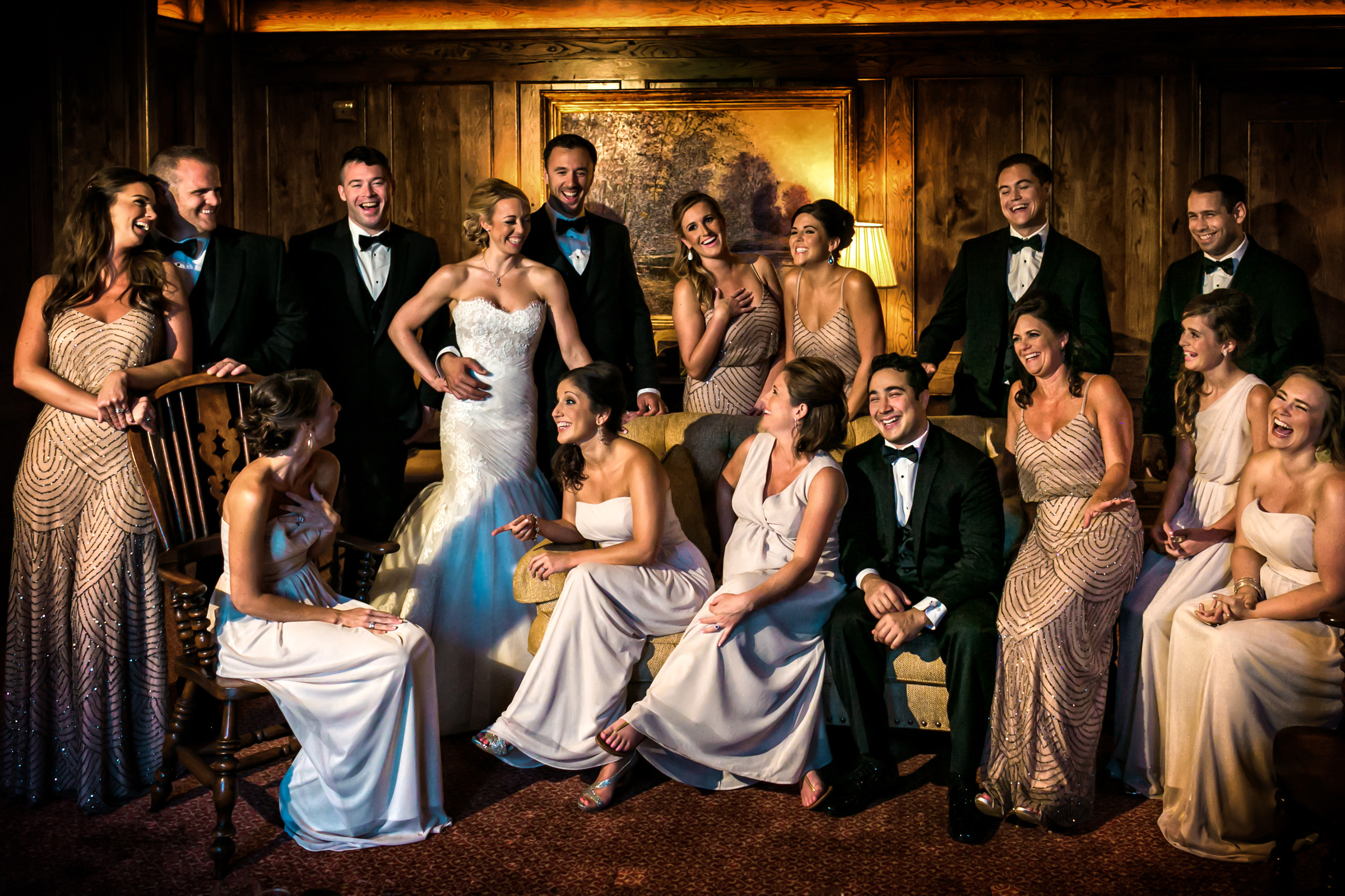 Animated group shot with bride and groom - photo by Christophe Viseux Photography