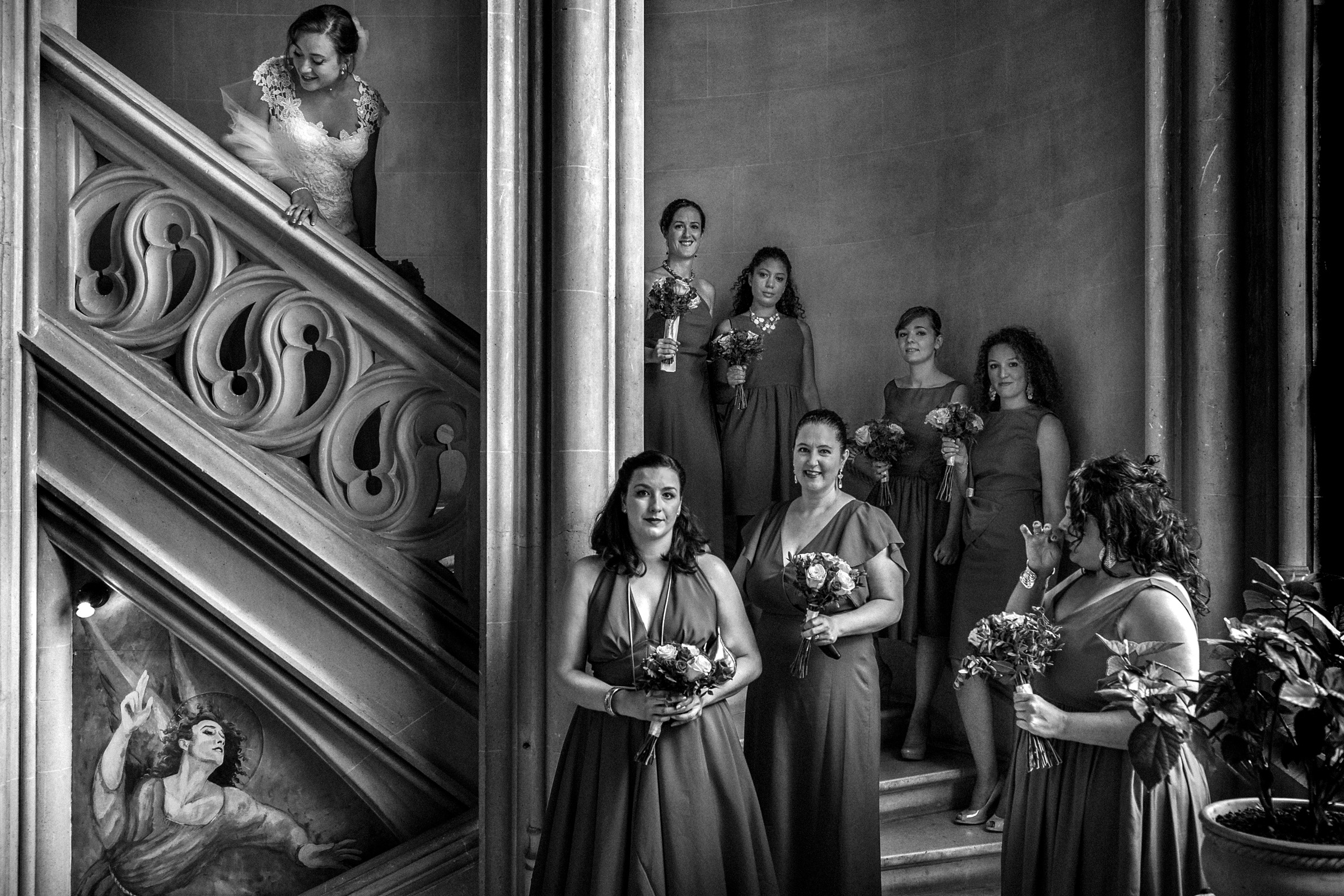 Bride descending staircase to bridesmaids - photo by Christophe Viseux Photography