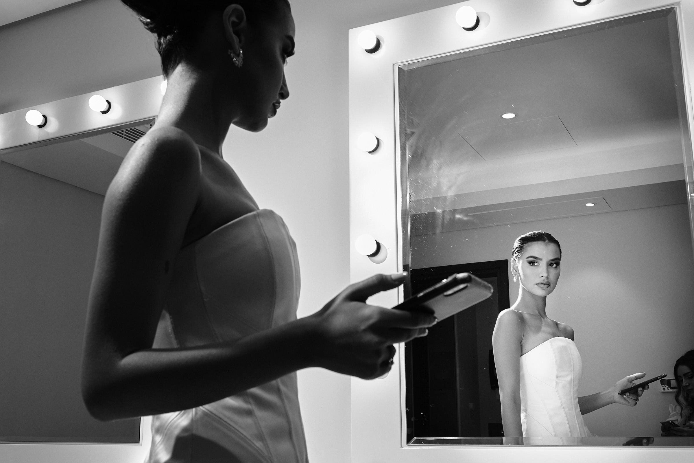 Bride in mirror - photo by Christophe Viseux Photography
