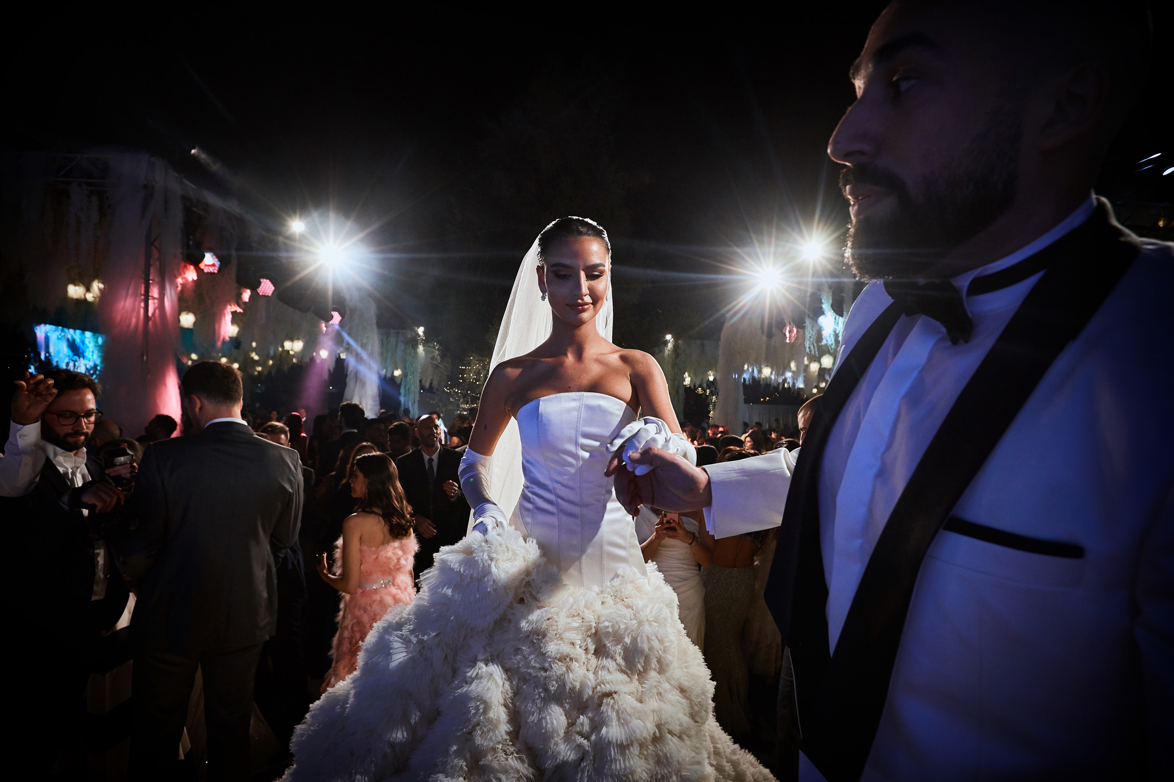 Bride takes groom's hand at reception - photo by Christophe Viseux Photography
