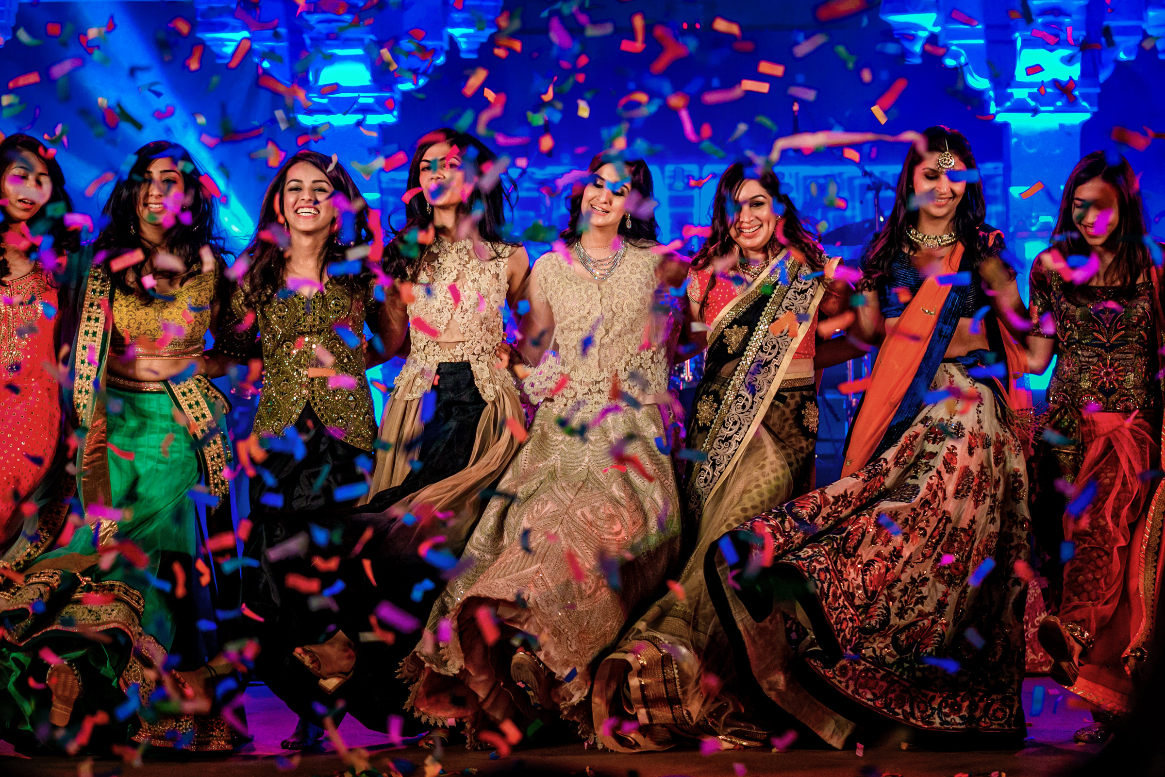 Colorful composition of bridesmaids dancing - photo by Christophe Viseux Photography