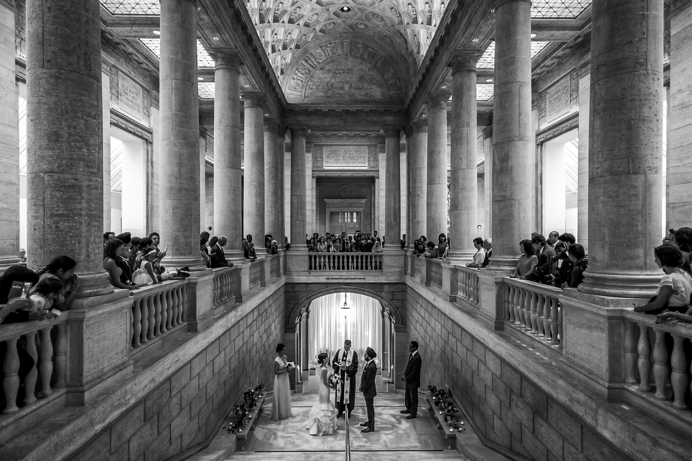 Creative composition of ceremony in columned building - photo by Christophe Viseux Photography