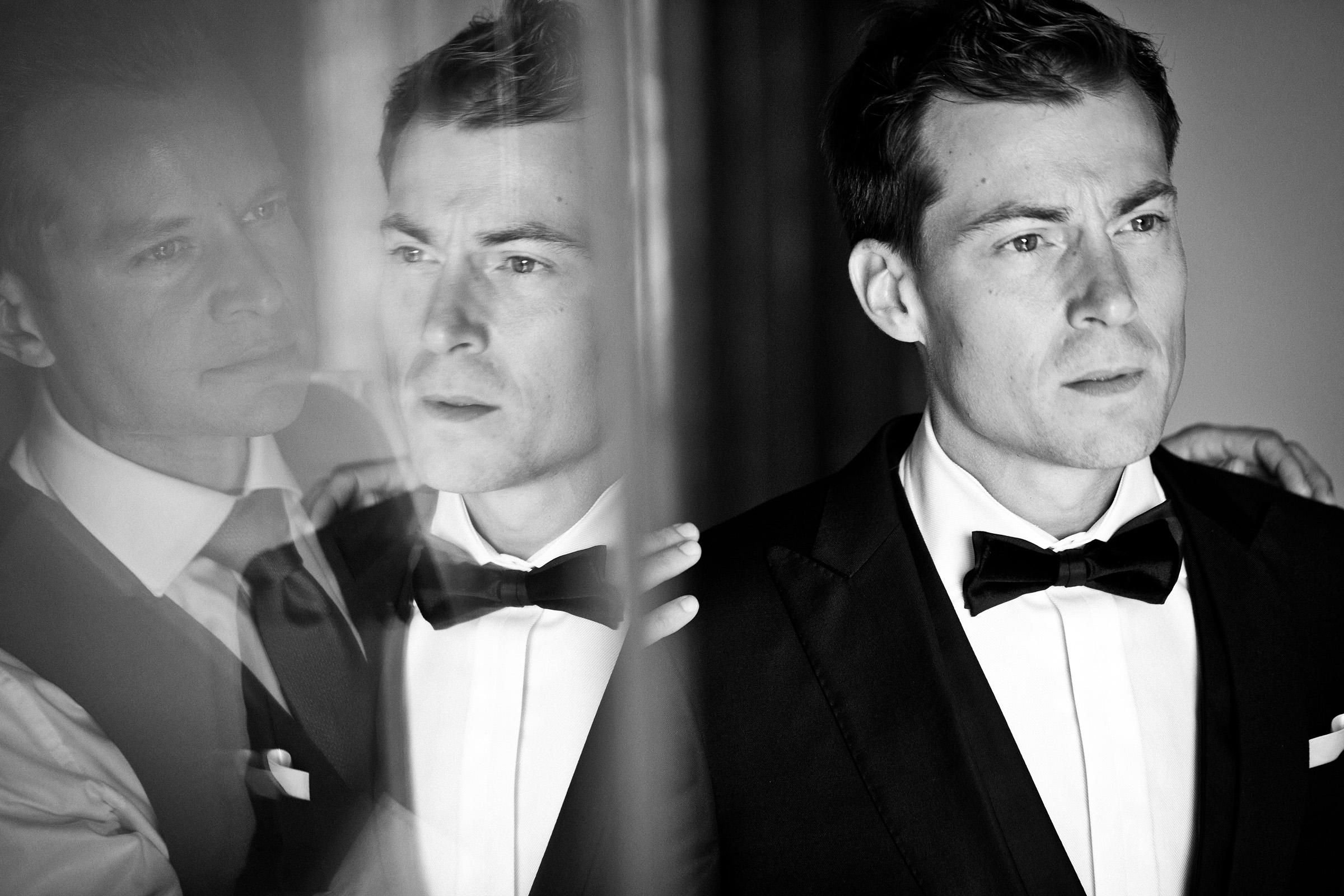 Groom reflected - photo by Christophe Viseux Photography