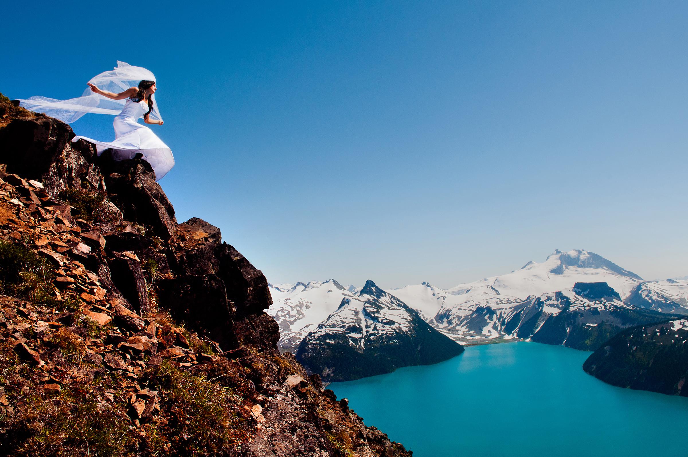 Bride with veil above Garibaldi Lake - photo by Jozef Povazan Photography