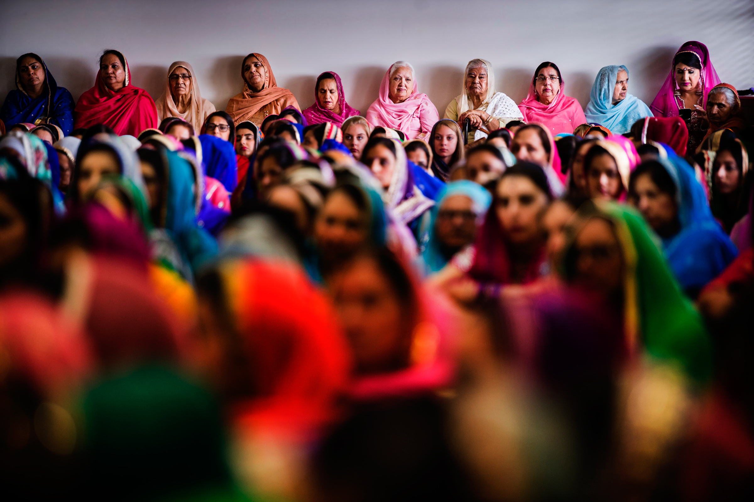 Colorful group shot of women at sikh wedding - photo by Jozef Povazan Photography