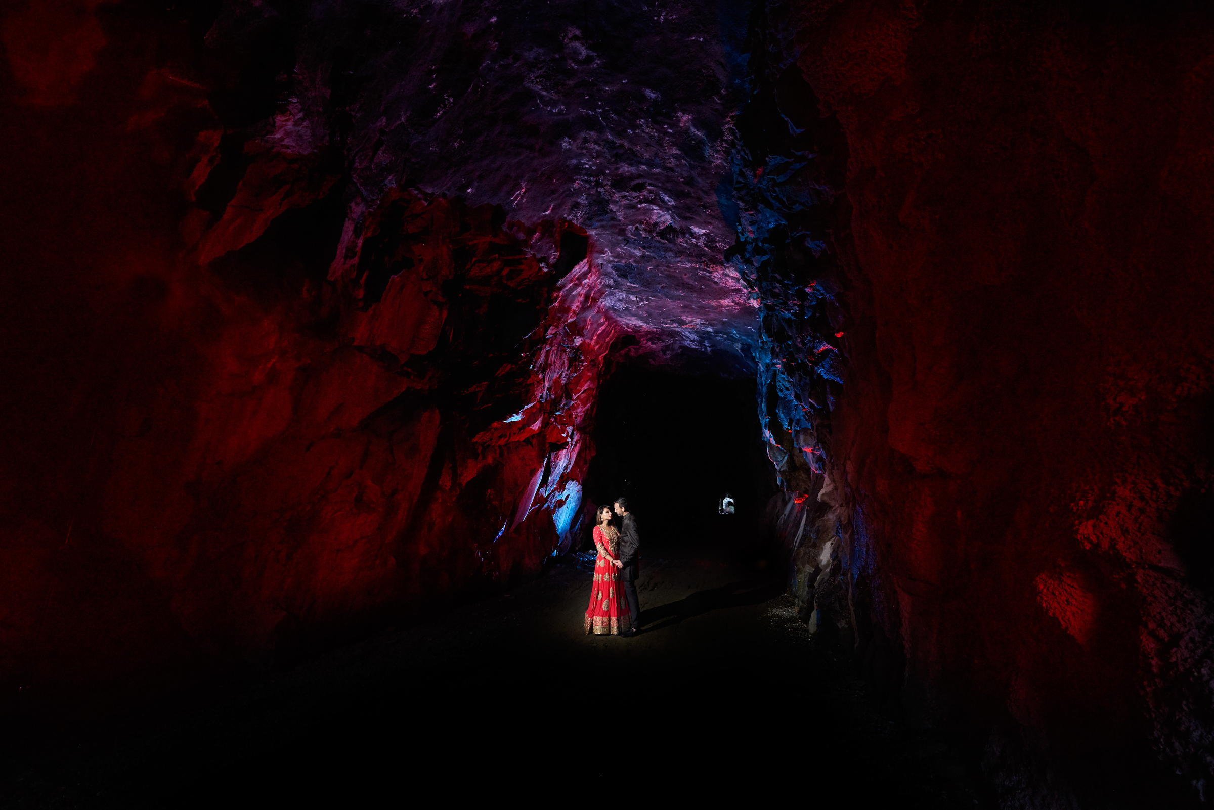 Couple at entrance to cave - photo by Jozef Povazan Photography