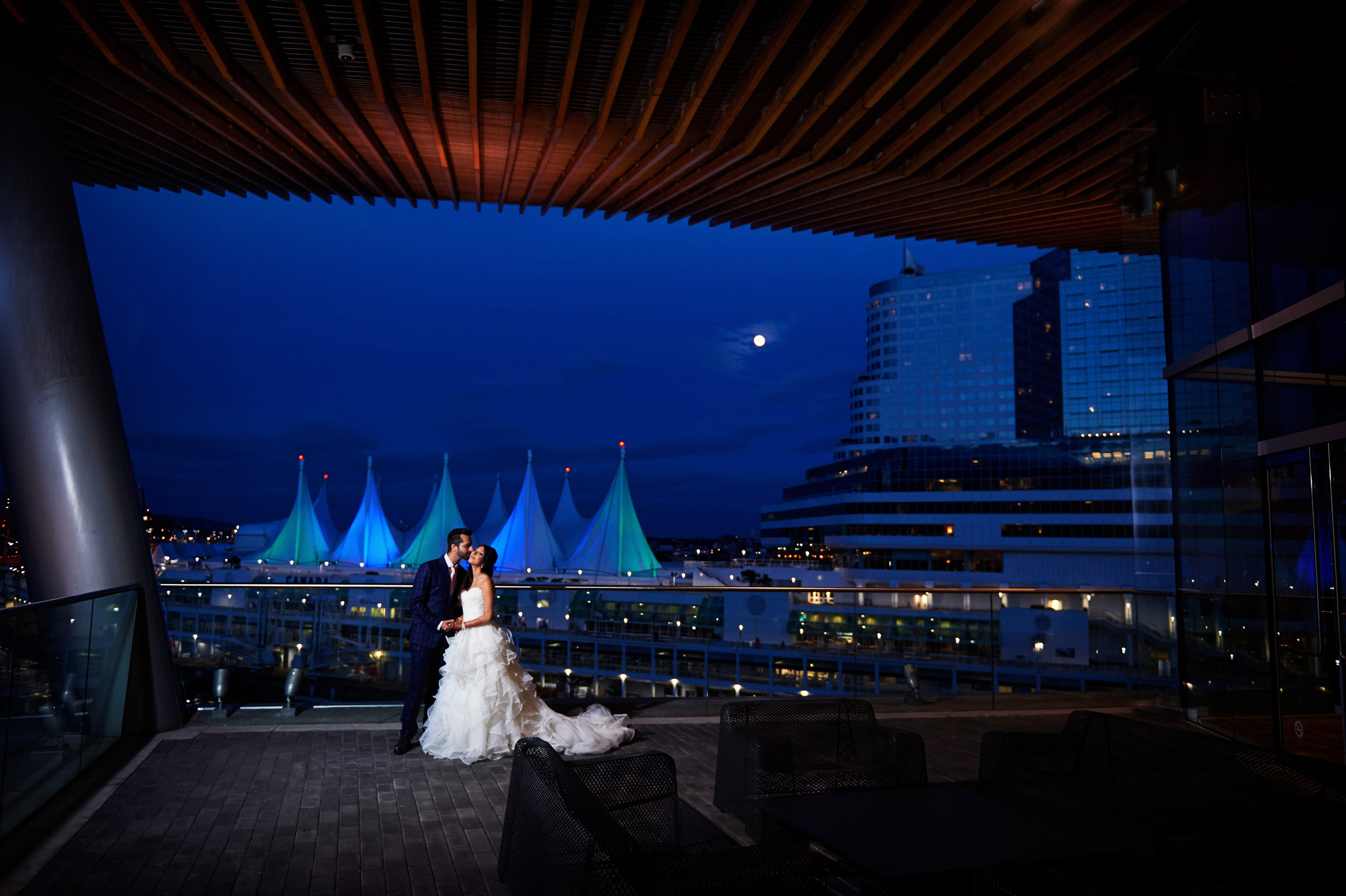 Couple portrait on deck of Vancouver Convention Centre - photo by Jozef Povazan Photography