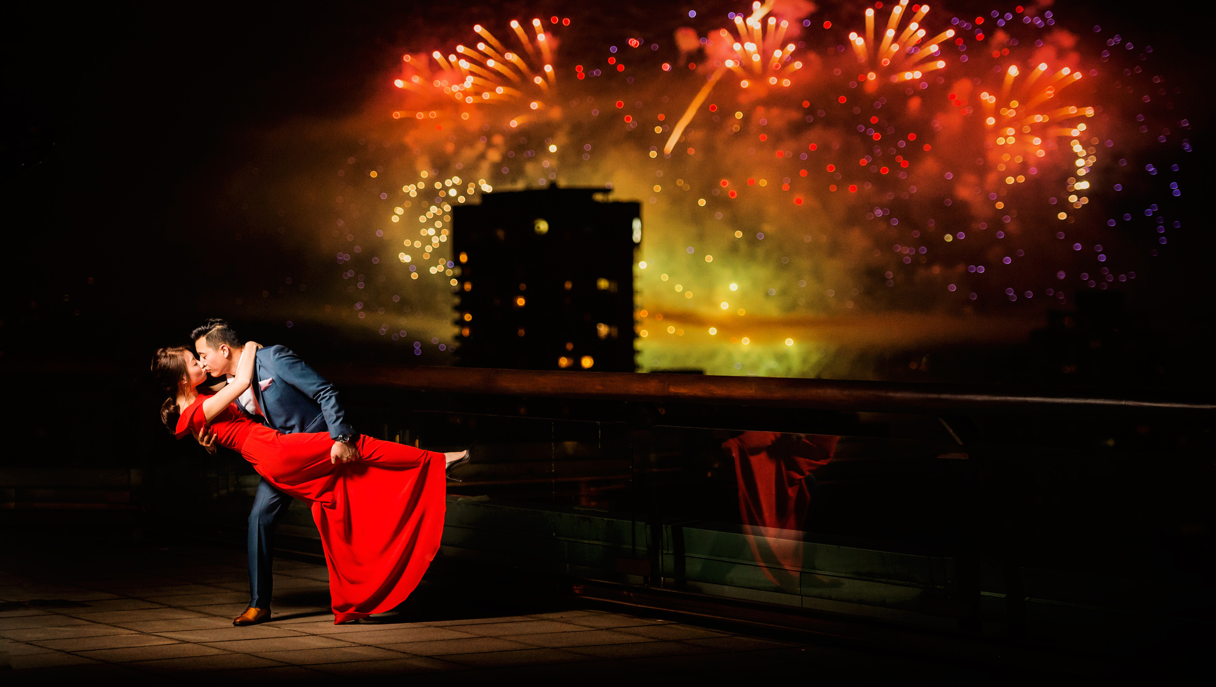 Dramatic engagement kiss against fireworks - photo by Jozef Povazan Photography