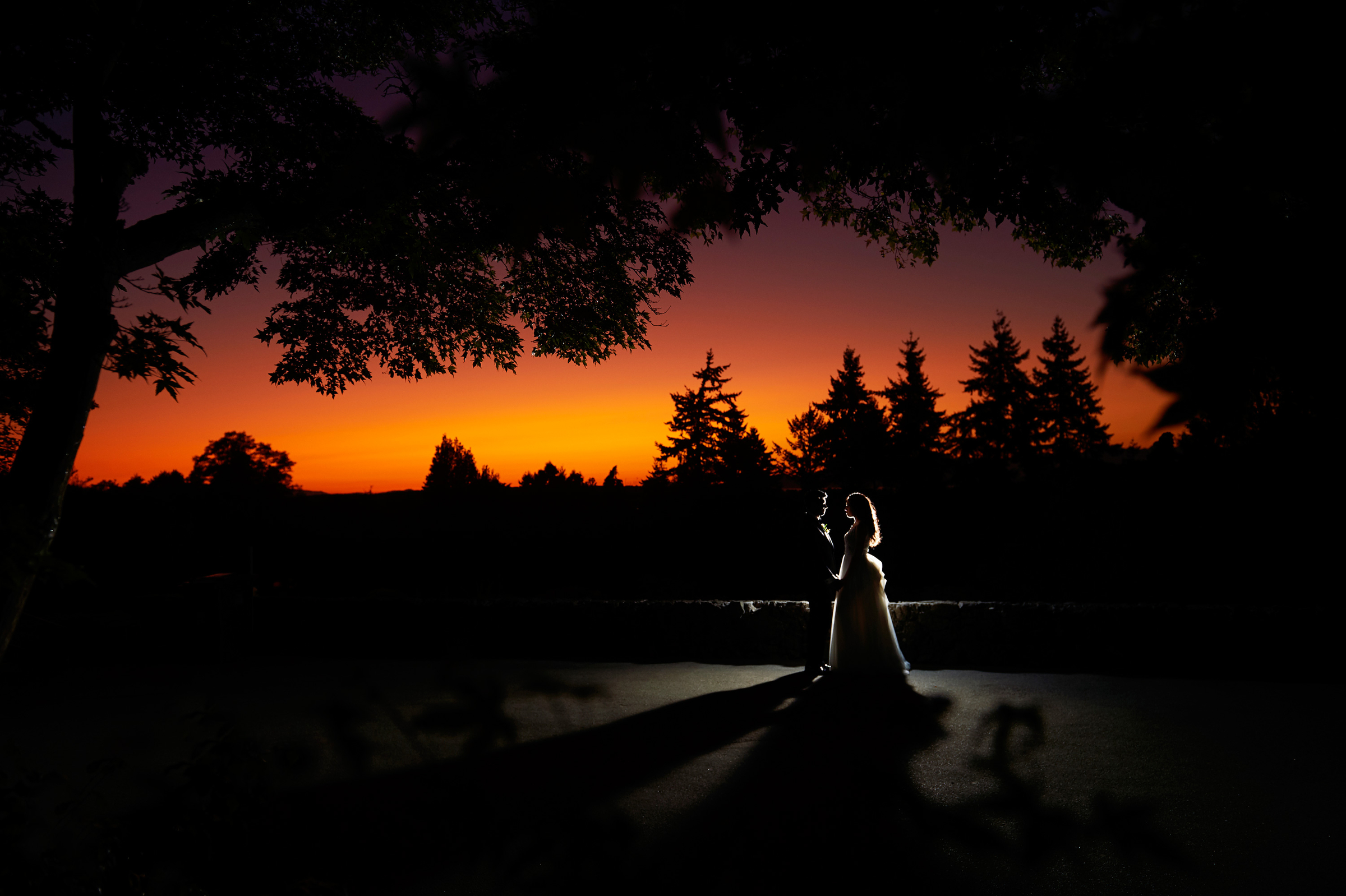Highlighted couple silhouette against sunset - photo by Jozef Povazan Photography