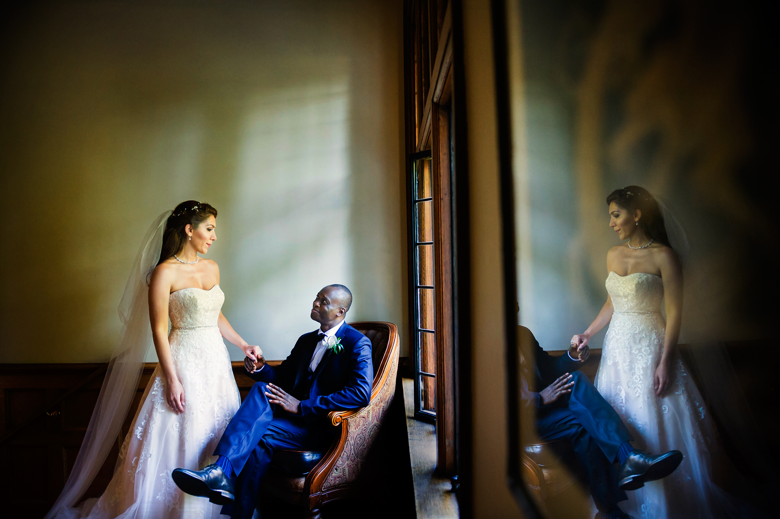 Reflection photo of bride and groom in mirror - photo by Jozef Povazan Photography
