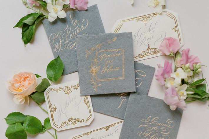Grey and ivory wedding invitations by truffy pi - flat lay photo by Greg Finck