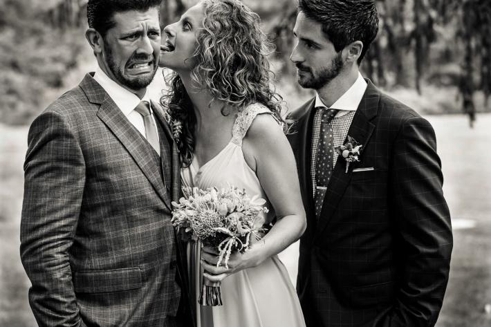 Bride surprises guest with wet willy - photo by JAG Studios