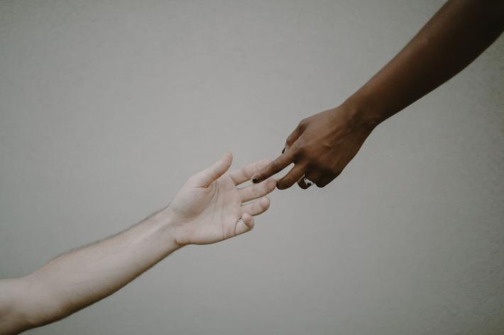 dark and light hands of lovers touching fingers - photo by Kristen Marie Parker