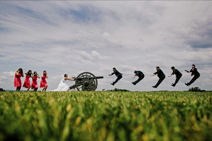 Groomsmen being shot out of a cannon - wedding party portrait by Ken Pak