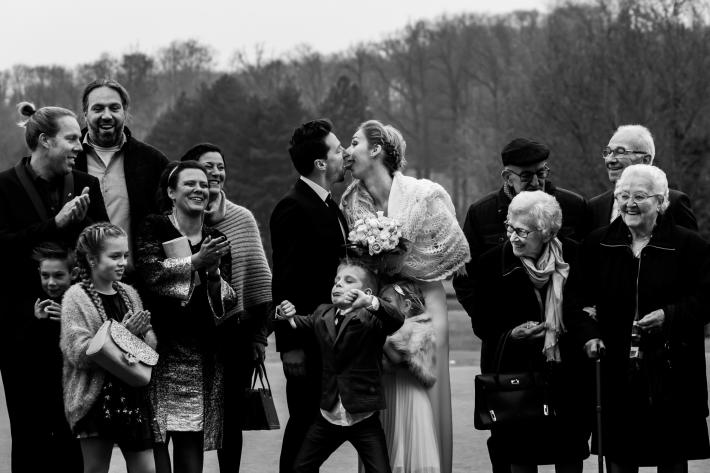 Boy gives thumbs down to ceremony kiss - photo by Fotobelle