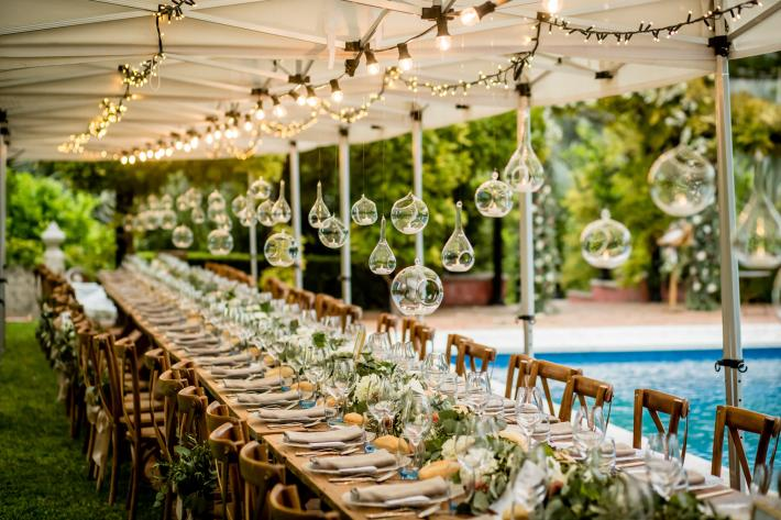 Reception table with hanging glass orbs photographed by Eppel Photography