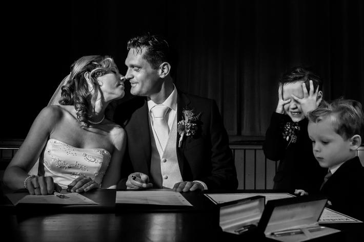 Boy shuts his eyes to block couple's kiss - photo by Fotobelle