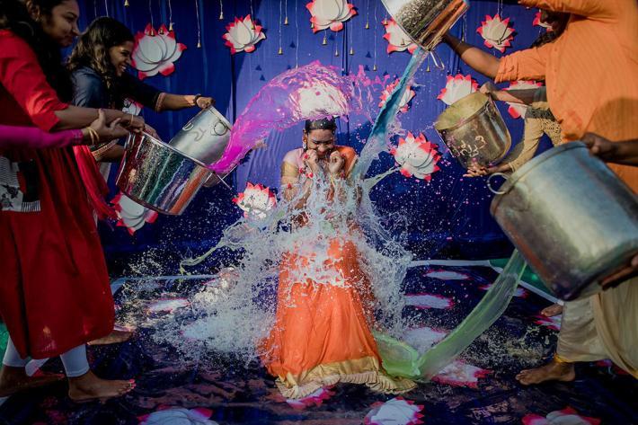 Joyful Mangala Snanam ritual photographed by Rimi Sen