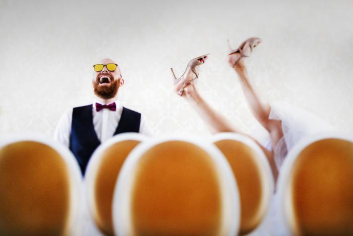 Funny photo of bride falling backward by Victor Lax
