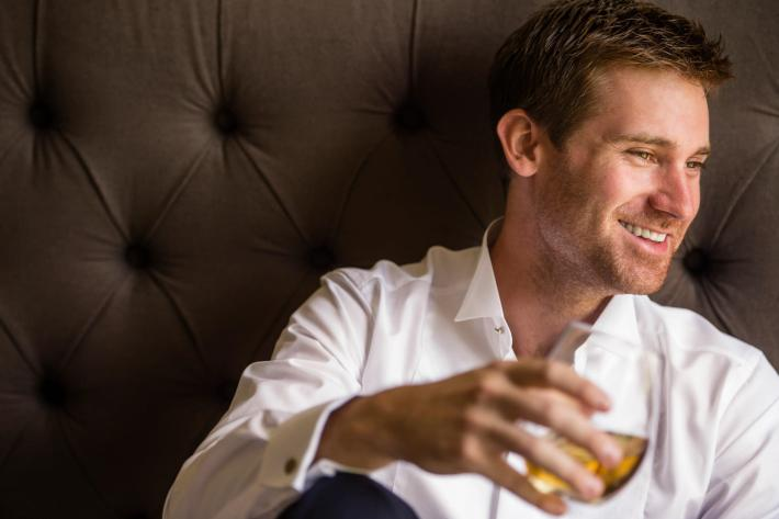 handsome-groom-with-glass-of-scotch-wedding-photos-jerry-ghionis