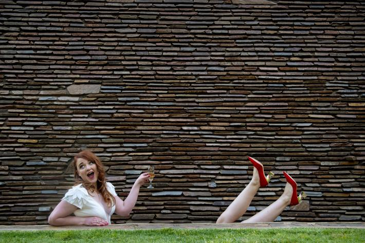 funny-composition-of-bride-and-friend-wearing-red-shoes-by-jacki-bruniquel