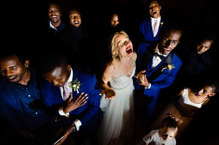 Bride sings with joy surrounded by choir - photo by Jos & Tree - Portland photographers
