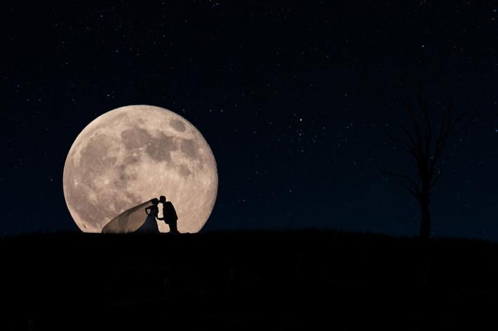 Silouhette of bride and groom in front of the moon by David and Sherry Buck, Toronto