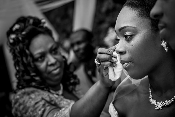 Mother wipes away bride's tears during wedding ceremony - photo by Davina plus Daniel