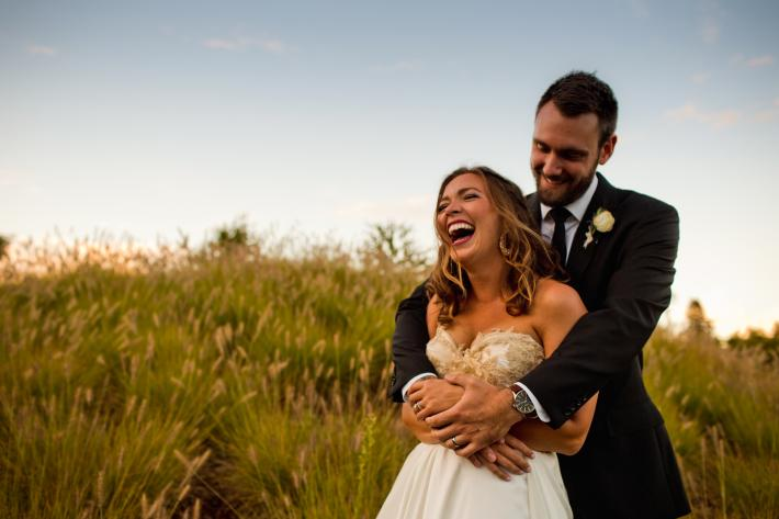 Happy couple in grass field near Portland Oregon - photo by Jessica Hill Photography