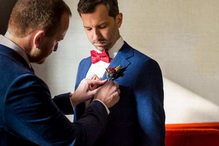 Groom getting thistle boutonniere fastened - photo by Procopio Photography - DC wedding