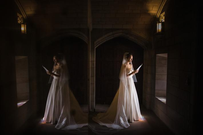 Reflection photo of bride reading her vows in soft windowlight by Susan Stripling - New York wedding photographer